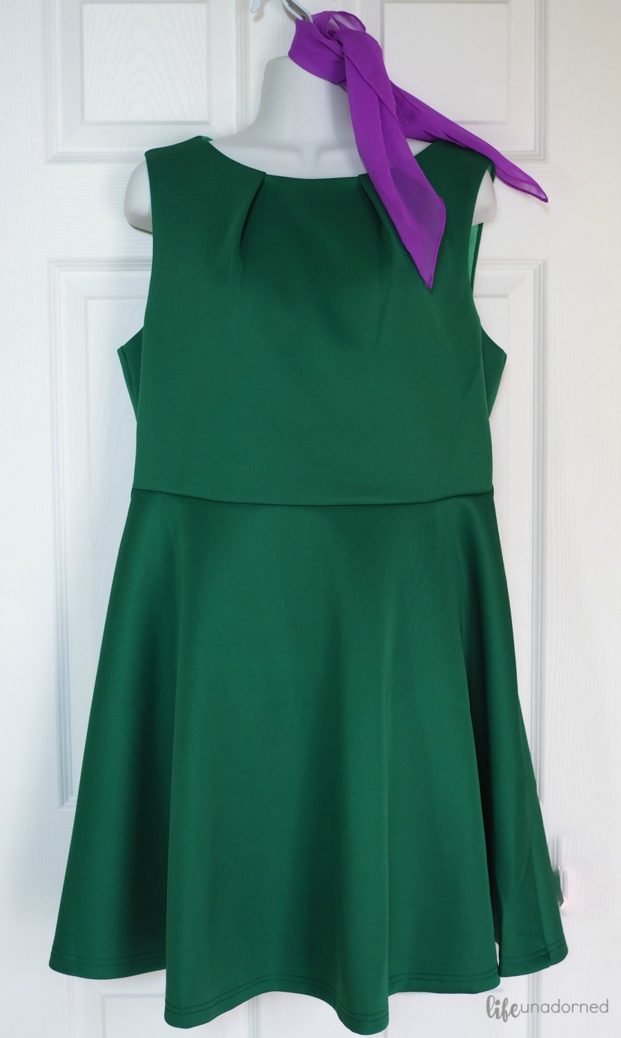 green dress and purple scarf
