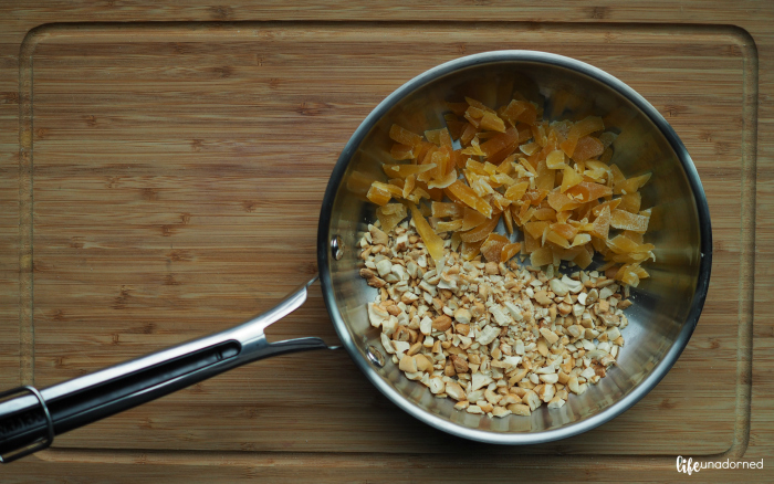dried mangoes and cashews in a saute pan