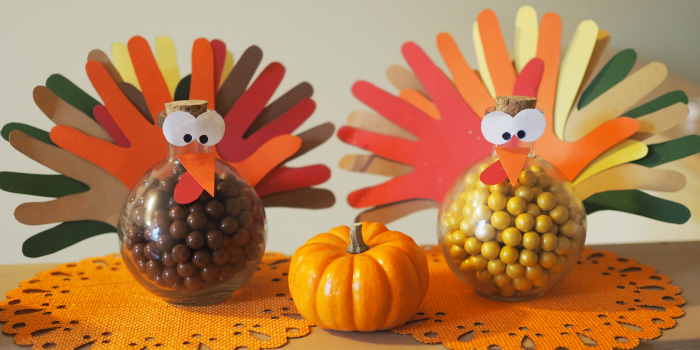 kids craft of two handprint turkey candy jars with a pumpkin for Fall Thanksgiving gift ideas